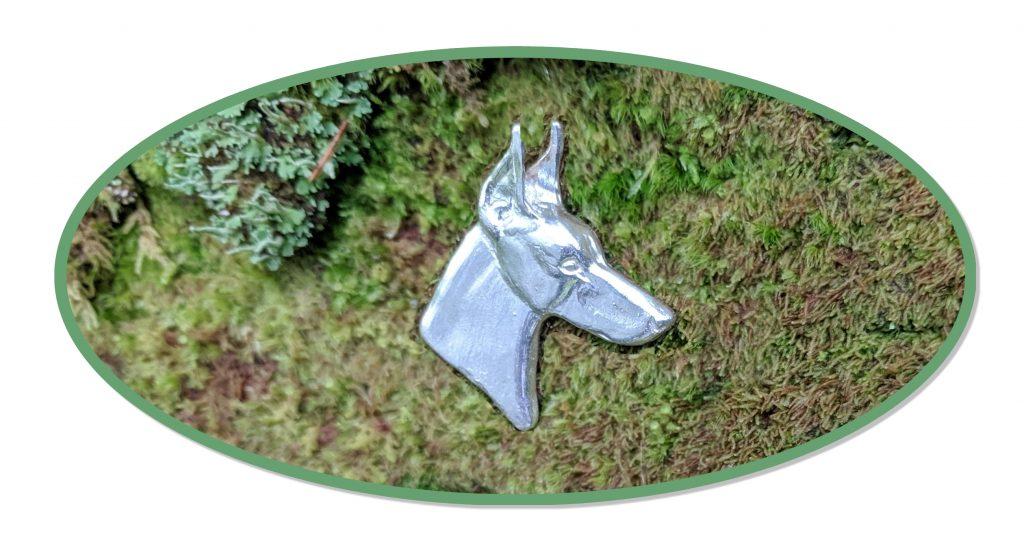 Doberman Pinscher jewelry sterling silver doberman head on moss and lichen backdrop