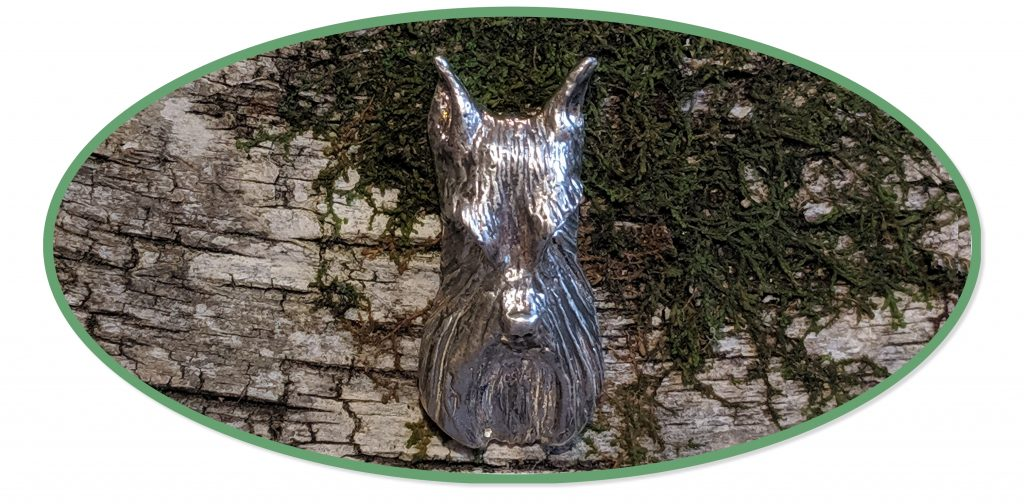 Sterling Schnauzer Jewelry by Elizabeth Trail on natural birch bark and moss backdrop